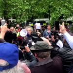 Piers Corbyn and his megaphone - Photo Youtube/Reuters/The Sun