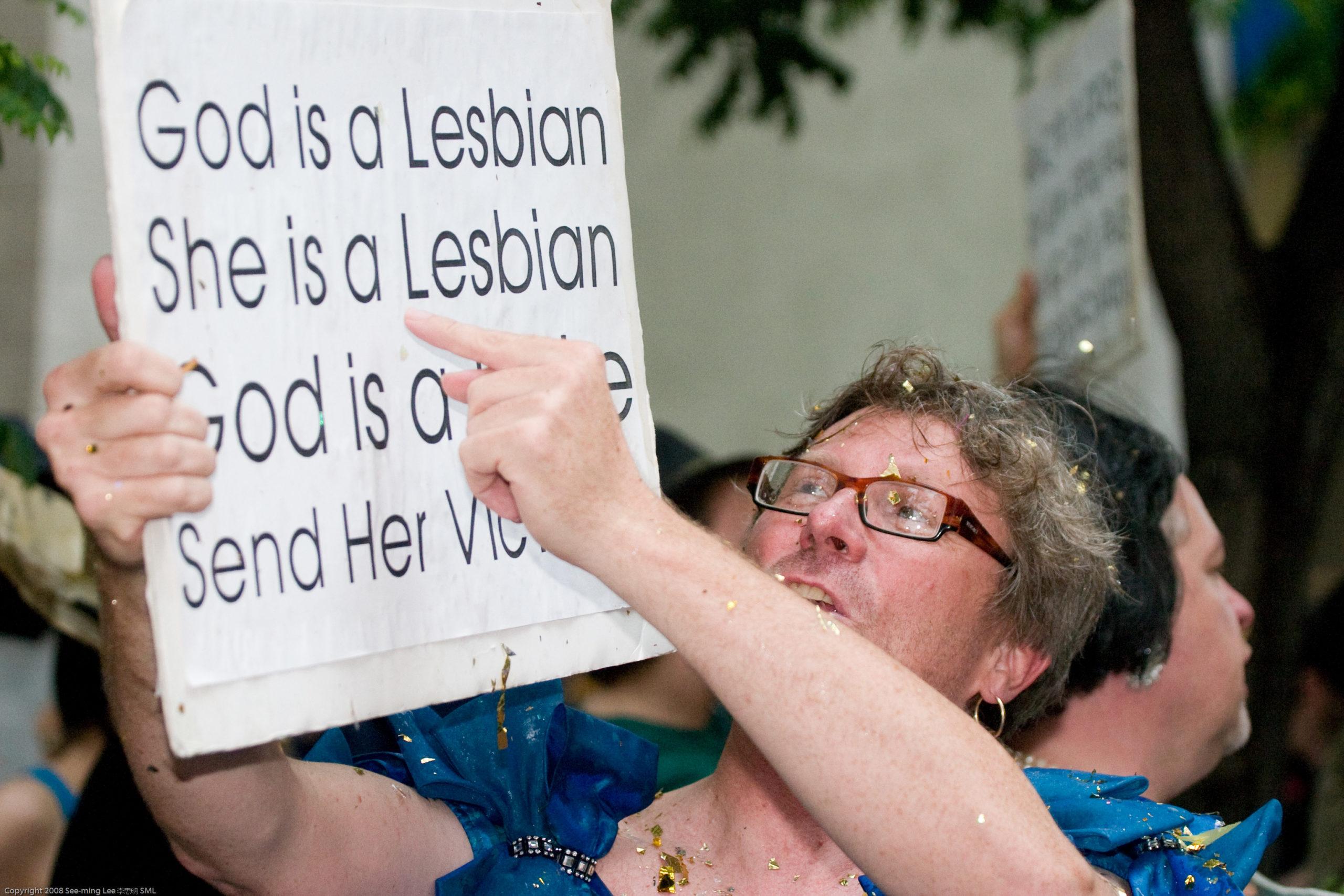 A man holding a sign